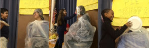 "Several staff members from Fine Elementary got ""pied"" by students as part of a fundraiser for the Leukemia & Lymphoma Society. Joshua Limon-Vargas pied kindergarten teacher Mrs. Seaver; Cristina Abou Harb pied kindergarten teacher Ms. Fox; and Miriyama Muhammad pied educational assistant Mr. Smith."