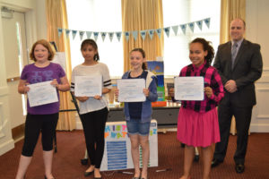 Students with the top entries in the MPWC's annual Drinking Water Week poster contest were recognized during the utility's May Commission Meeting. Pictured, from left to right: Abigail Morgan, Merchantville Elementary School; Ayen Aldana, Pennsauken Intermediate School; Claudia Szentesy, Merchantville Elementary School; Taylor Meachum, Merchantville Elementary School; and MPWC Commission President, Joseph Scavuzzo.